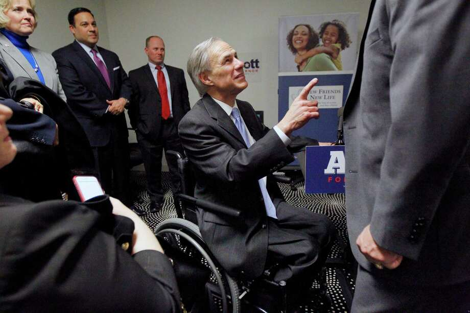 Texas Republican candidate for governor, Greg Abbott, greats supporters, Tuesday, Feb. 4, 2014  in Dallas. Republican Greg Abbott pledged Tuesday to double border security spending if elected Texas governor while deflecting talk of Democratic opponent Wendy Davis and her scrutinized biography that has dominated the race in recent weeks. (AP Photo/The Dallas Morning News, Mona Reeder)  MANDATORY CREDIT; MAGS OUT; TV OUT; INTERNET USE BY AP MEMBERS ONLY; NO SALES Photo: Mona Reeder, Associated Press / The Dallas Morning News