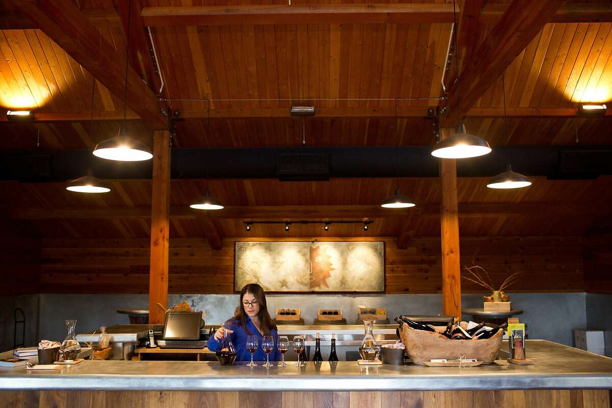 Allison Caruso, above, pours wine at the Turley tasting room, which features Turley wines only available there.