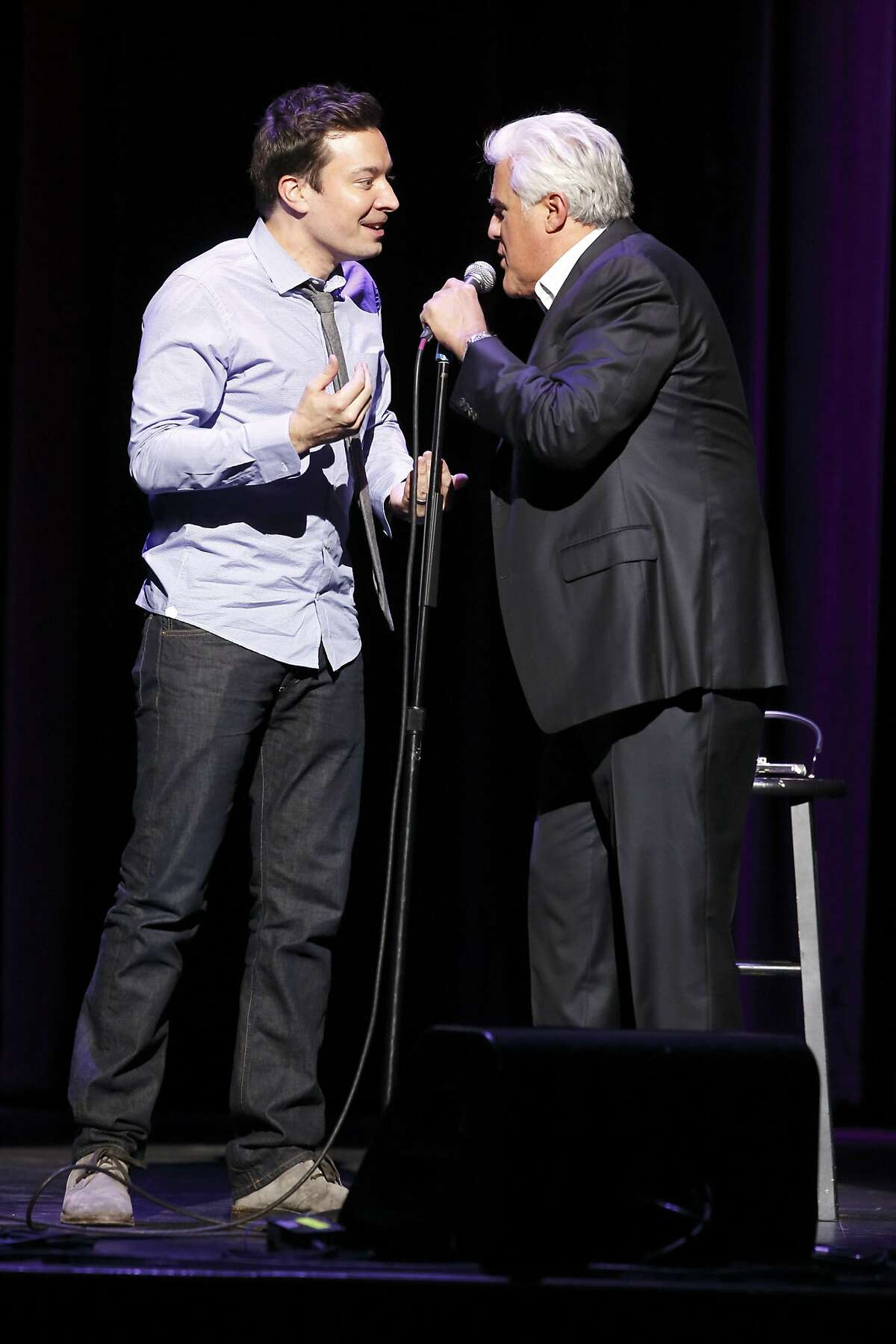 """NBCUNIVERSAL EVENTS -- Jimmy Fallon's Clean Cut Comedy Tour -- Pictured: December 5, 2013 - Jay Leno makes a surprise appearance at Jimmy Fallon's Clean Cut Comedy Tour in Los Angeles, CA. Leno will pass the """"Tonight Show"""" hosting torch to Fallon when """"The Tonight Show Starring Jimmy Fallon"""" premieres February 17, 2014 on NBC."""