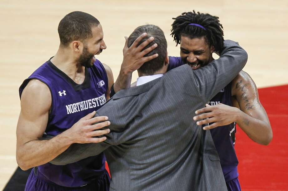 Northwestern's Drew Crawford (left) and JerShon Cobb celebrate with coach Chris Collins after wrapping up a win at Wisconsin last Wednesday, part of a rare three-game road win streak. Photo: Andy Manis, Associated Press