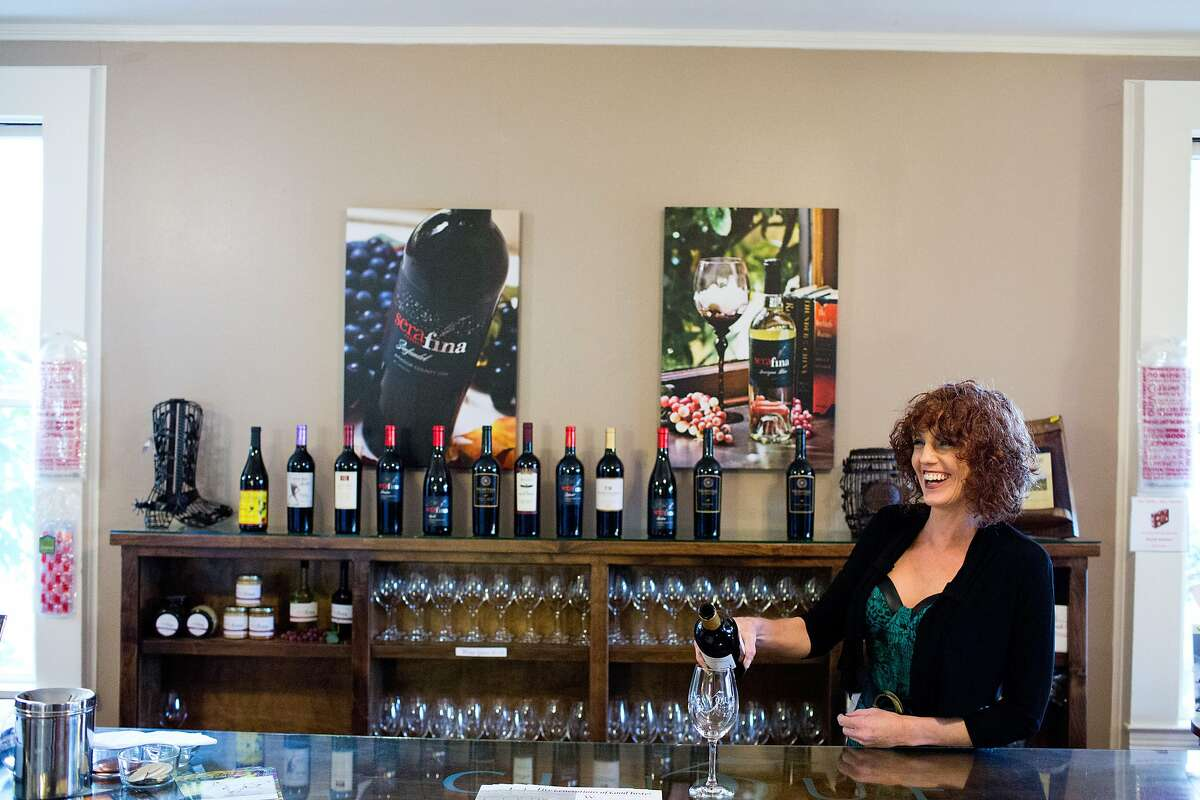 The Cinque tasting room is in a white clapboard house surrounded by a picket fence and features dog friendly staff like Alicia Noland pouring wine here in Sutter Creek, Calif., Thursday, January 30, 2014.