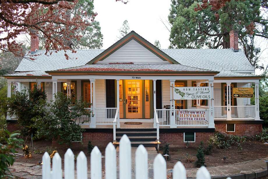 At BellaGrace tasting room in Sutter Creek you can soak up history, wine and olive oil while admiring the restored 1850s home with its original foot-thick pine walls. Photo: Jason Henry, Special To The Chronicle