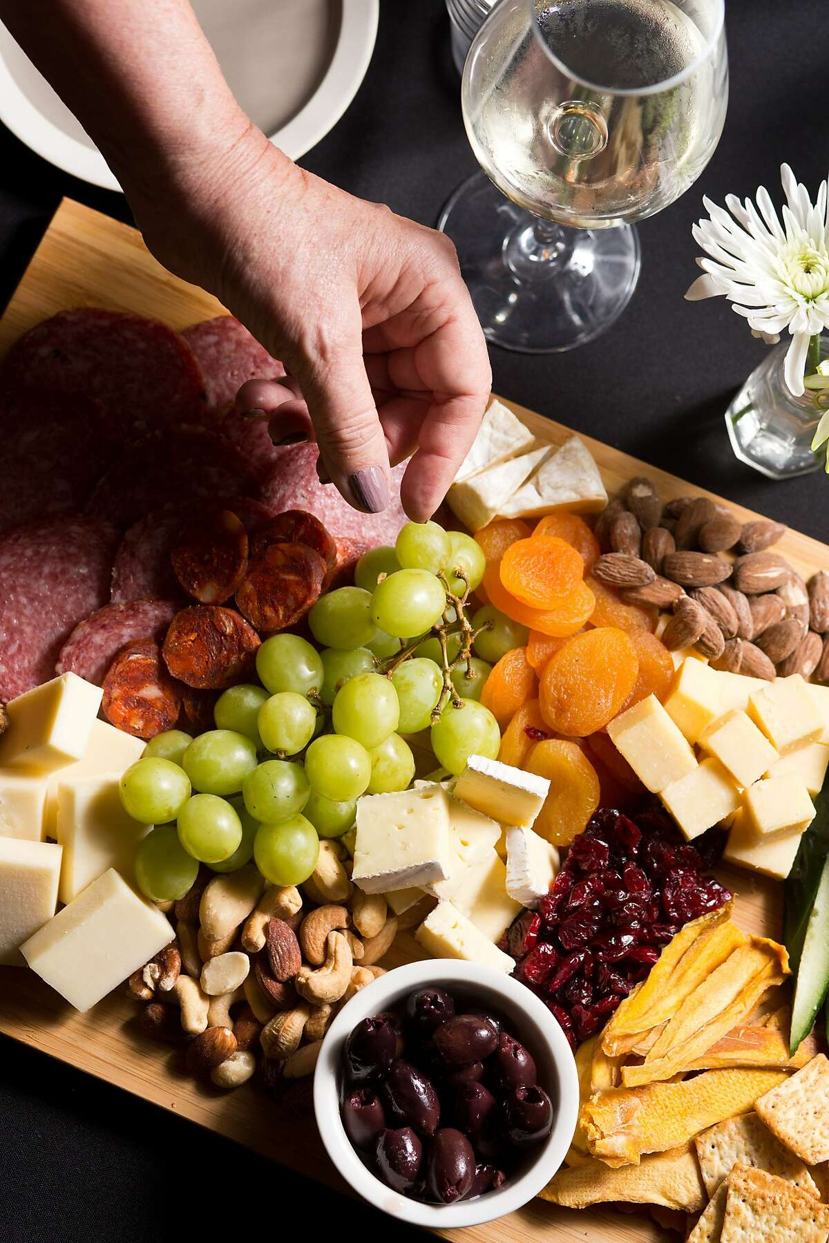 The newly renovated Hotel Sutter offers a restaurant, bar and basement bar called The Cellar with live music in Sutter Creek, Calif., Thursday, January 30, 2014. Here a large farm house cheese plate with salami fruit and nuts for sharing.