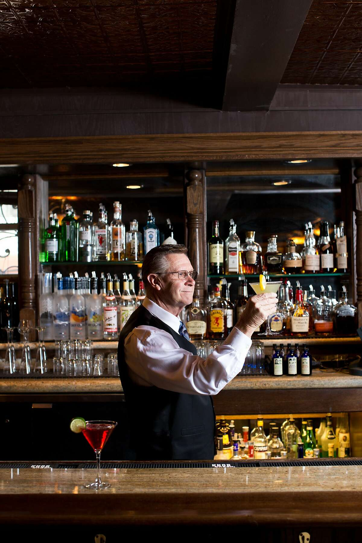 Bartender Dan Bryan mans the bar downstairs at the recently renovated National Hotel in Jackson, Calif., Thursday, January 30, 2014.