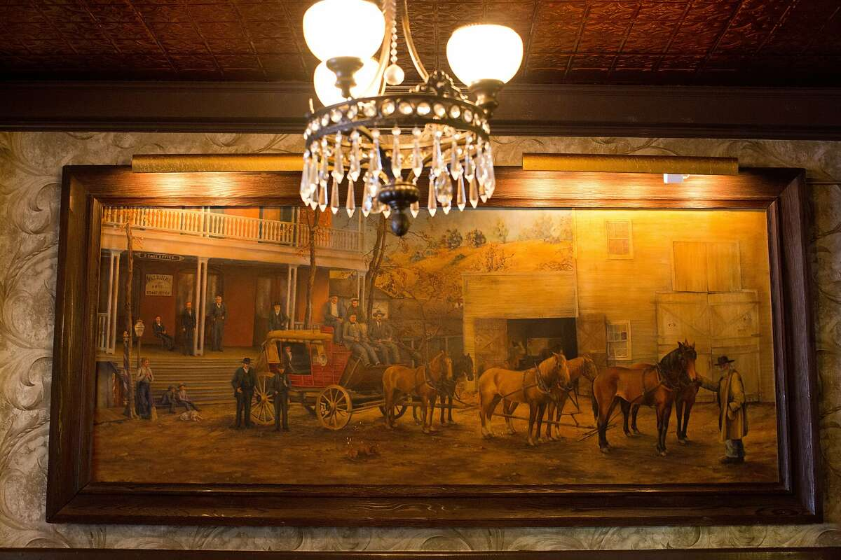 Old decor takes you back in time in the recently renovated National Hotel in Jackson, Calif., Thursday, January 30, 2014. Here a painting of the structure with horse and buggy hangs in the lobby.