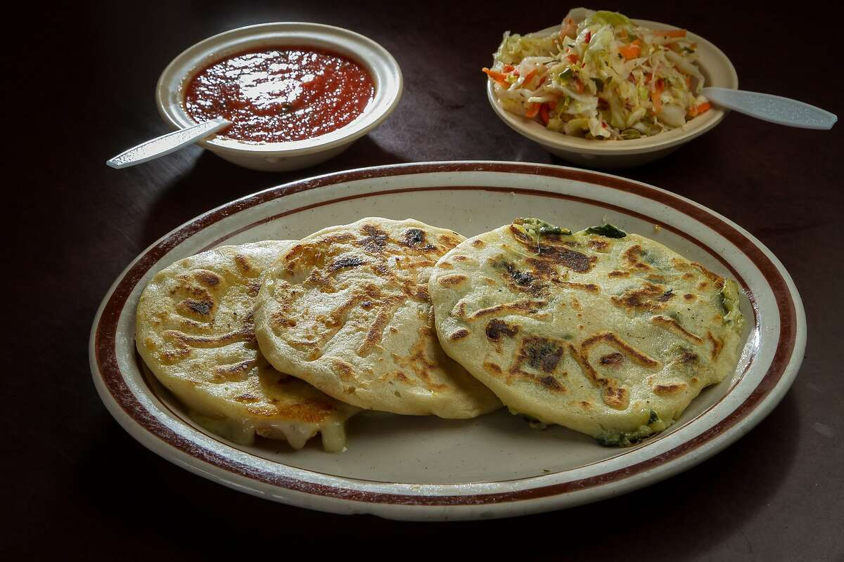 Left to right: Chicken with Loroco Pupusa, Chicken with Cheese Pupusa, and Spinach with Cheese Pupusa at Reina's restaurant in San Francisco, Calif., are seen on February 4th, 2014.