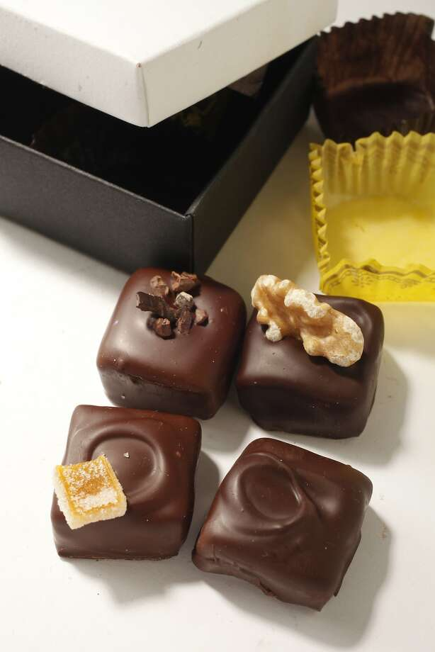 This assortment of four chocolates from Gâté Comme des Filles includes one made with Chronicle honey. Photo: Craig Lee, Special To The Chronicle
