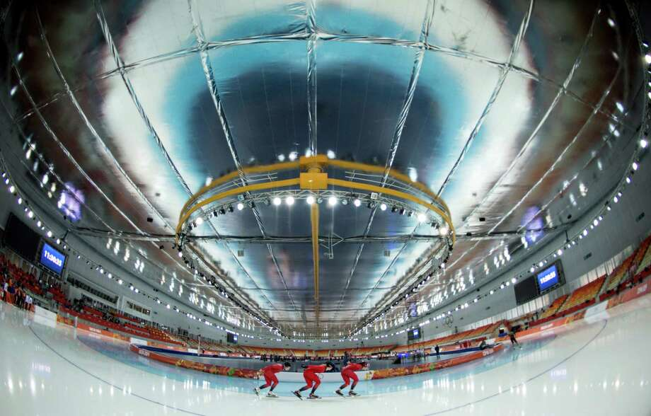 Members of the Norwegian speedskating team round the track at Adler Arena Skating Centre at the Sochi Winter Olympics, Tuesday, Feb. 4, 2014, in Sochi, Russia. (AP Photo/The Canadian Press, Paul Chiasson) Photo: Paul Chiasson, Associated Press / The Canadian Press