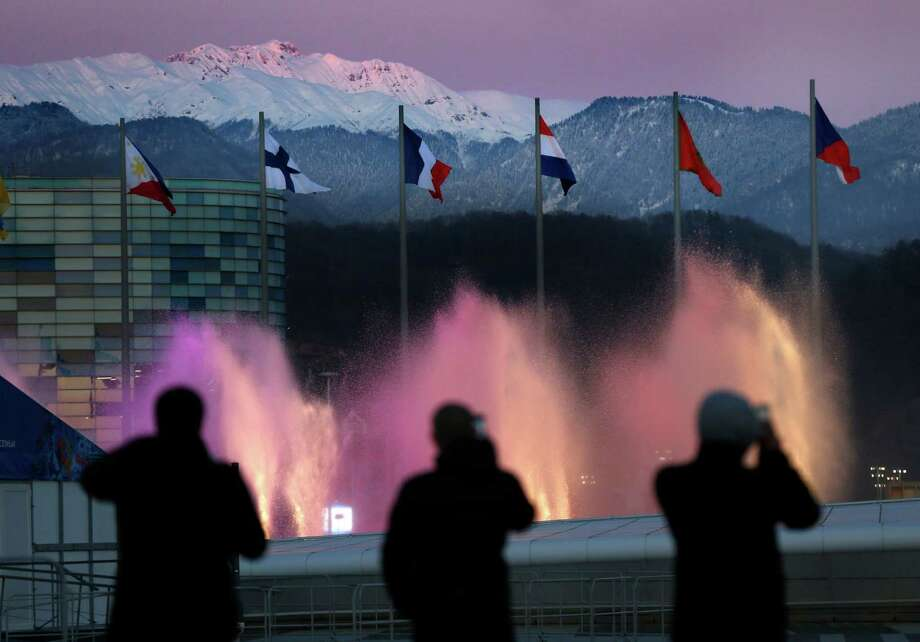 Spectators photograph water fountains at Olympic Park during final preparations before the 2014 Winter Olympics, Monday, Feb. 3, 2014, in Sochi, Russia. The opening ceremony for the games is Feb. 7, and the competition will run until Feb. 23. (AP Photo/Robert F. Bukaty) Photo: Robert F. Bukaty, Associated Press / AP