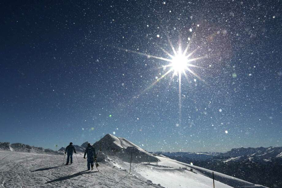 Skiers reach the top of a mountain near the start of the men's downhill ski course ahead of the 2014 Winter Olympics, Monday, Feb. 3, 2014, in Krasnaya Polyana, Russia. (AP Photo/Alessandro Trovati) Photo: Alessandro Trovati, Associated Press / AP