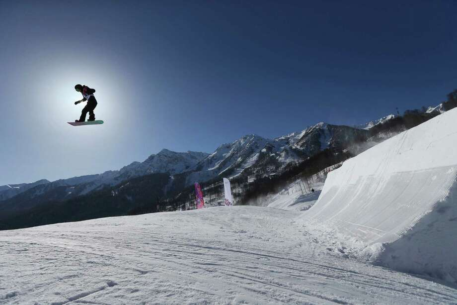 A competitor takes a jump during a Snowboard Slopestyle training session at the Rosa Khutor Extreme Park, prior to the 2014 Winter Olympics, Tuesday, Feb. 4, 2014, in Krasnaya Polyana, Russia. (AP Photo/Sergei Grits) Photo: Sergei Grits, Associated Press / AP