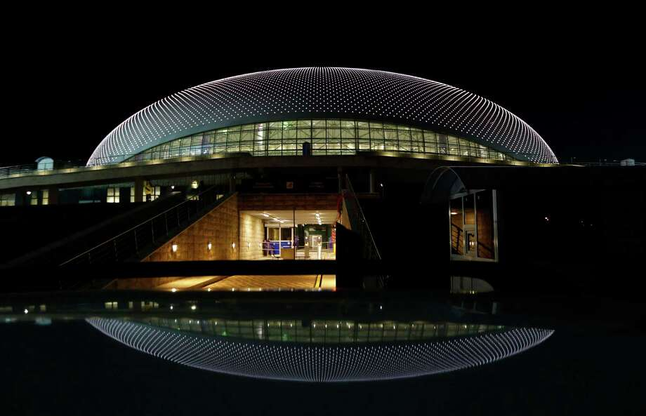 The Bolshoy Ice Dome is reflected in the roof of a car during final preparations for the 2014 Winter Olympics, Monday, Feb. 3, 2014, in Sochi, Russia. (AP Photo/Robert F. Bukaty) Photo: Robert F. Bukaty, Associated Press / AP