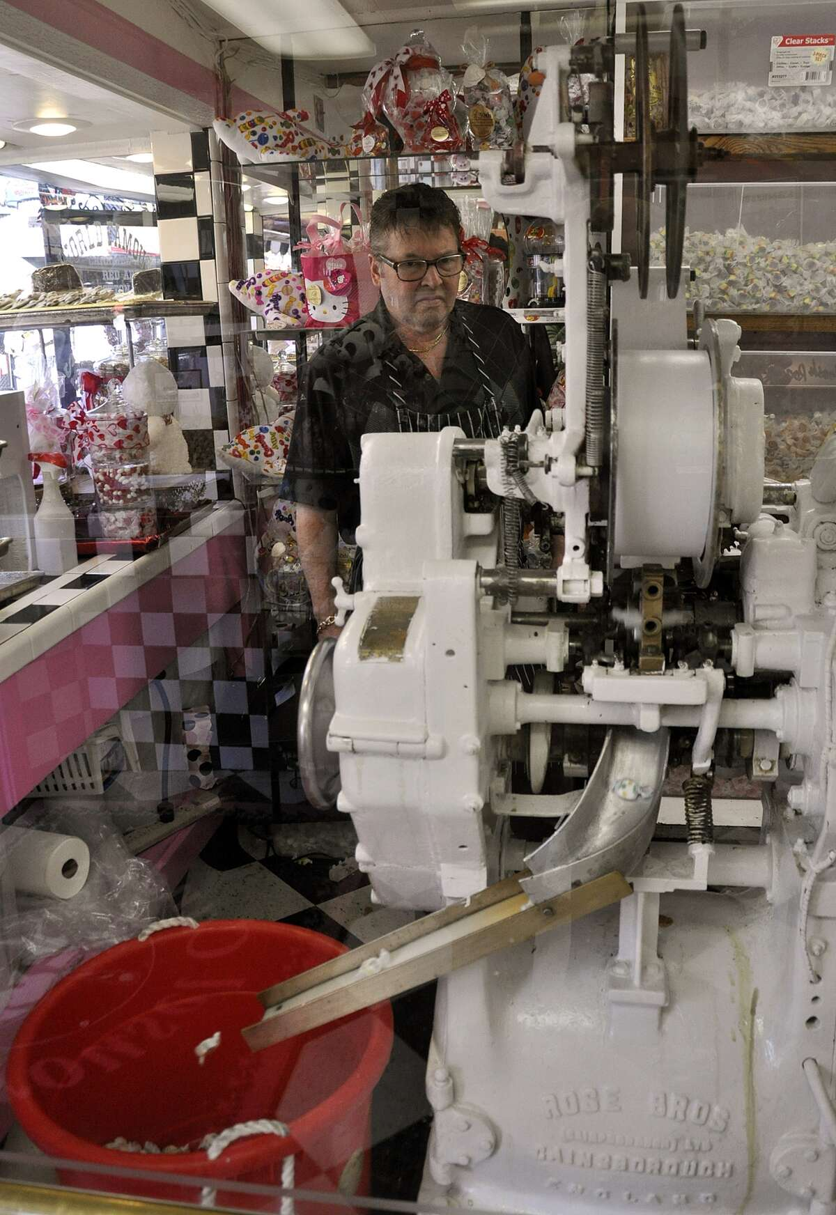 Watching the taffy being extruded, cut and wrapped behind the glass wall opposite the candy counter is a highlight of visiting the shop