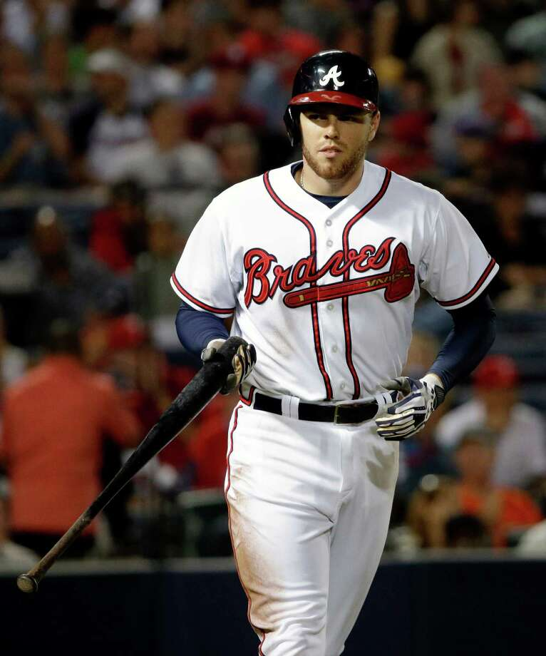 FILE - In this Sept. 26, 2013, file photo, Atlanta Braves' Freddie Freeman heads to first base after drawing a walk in the second inning of a baseball game against the Philadelphia Phillies in Atlanta. A person familiar with the talks says the Atlanta Braves have reached an agreement on an eight-year deal with Freeman that will be worth about $125 million. The person confirmed the agreement to The Associated Press on condition of anonymity on Tuesday, Feb. 4, 2014, because the Braves haven't announced the deal, which is subject to a successful physical. (AP Photo/David Goldman, File) ORG XMIT: NY168 Photo: David Goldman / AP