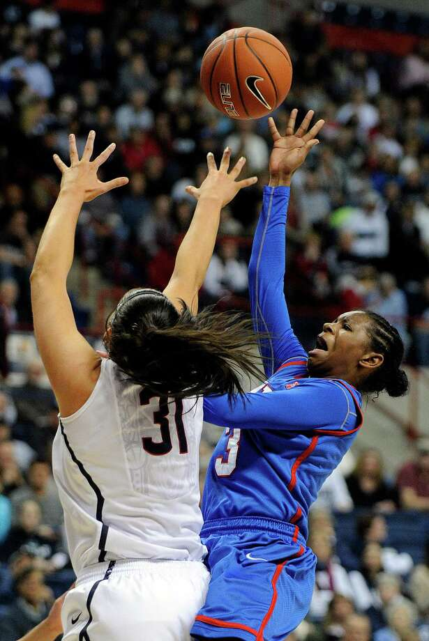 SMU's Gabrielle Wilkins (3) drives past Connecticut's Stefanie Dolson (31) during the first half of an NCAA college basketball game in Storrs, Conn., Tuesday, Feb. 4, 2014. (AP Photo/Fred Beckham) Photo: Fred Beckham, Associated Press / Associated Press