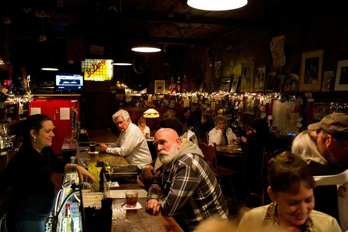 People drink inside the St. George Saloon in Volcano, Calif., Thursday, January 30, 2014.