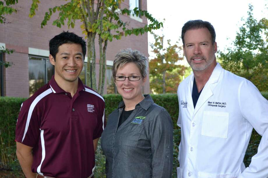 In this photo provided by Houston Methodist Sugar Land Hospital, orthopedic surgeon Dr. Mark Maffet, right, stands with physical therapist Toko Nguyen and patient Amy Statler, whose knee injury was treated with stem cells. Photo: Provided By Houston Methodist Sugar Land Hospital