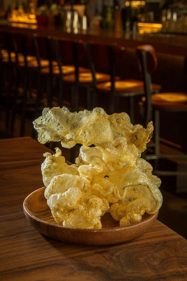 The beef tendon puffs ($6) are chicharrone-like creations that snap, crackle and pop as they wait to be devoured.  Photo: John Storey, Special To The Chronicle