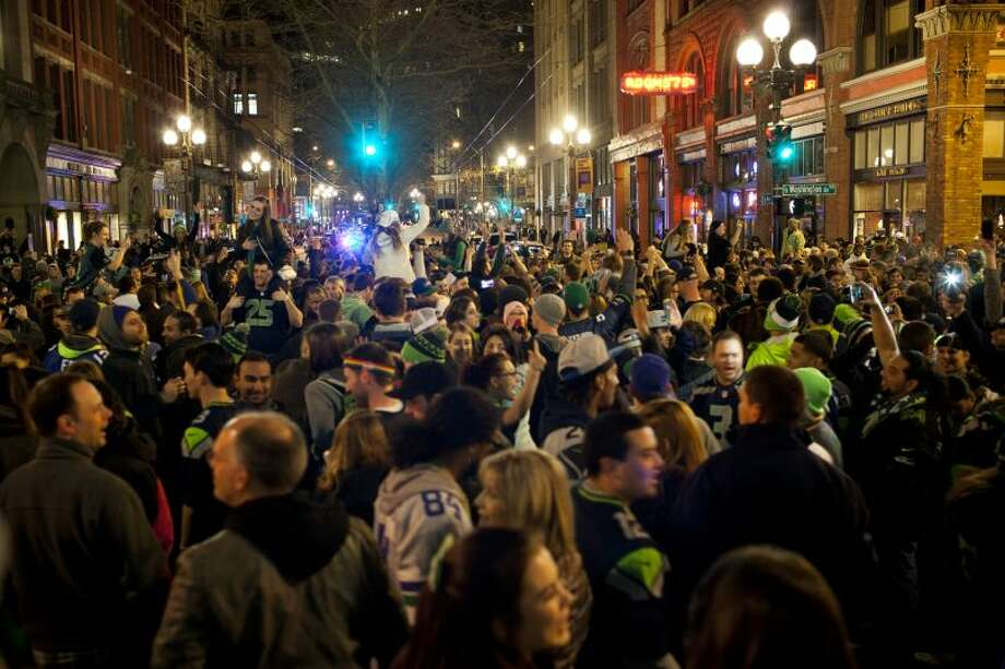 Fans celebrate on First Avenue in Pioneer Square after the Seattle Seahawks' 43-8 win against the Denver Broncos in Super Bowl XLVIII Sunday in Seattle. (Photo By By CHRIS WILSON/SPECIAL TO SEATTLEPI.COM)