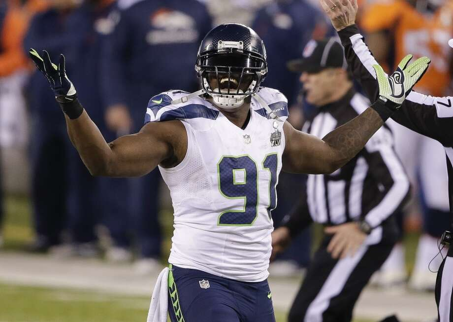 2. What does Seattle do with aging contributors on d-line? Chris Clemons played by far his best game of the season in Super Bowl XLVIII, but it might turn out to be his last game in a Seahawks uniform. While the team would undoubtedly like to bring back the nine-year veteran, his $9.67 million salary cap figure is tough to justify for a rotational player, which is what Clemons has become. Ditto fan-favorite defensive end Red Bryant -- the longest-tenured Hawk along with defensive tackle Brandon Mebane – who is due to make $8.5 million in 2014. Cutting both players would save Seattle over $18 million against next year's cap, but that likely won't happen. Instead, expect the team to approach both about restructuring their deals. But if Schneider can't get either or both to agree to terms he can live with, don't be surprised to see Clemons and Bryant move on to less-green pastures. Photo: Gregory Bull, ASSOCIATED PRESS