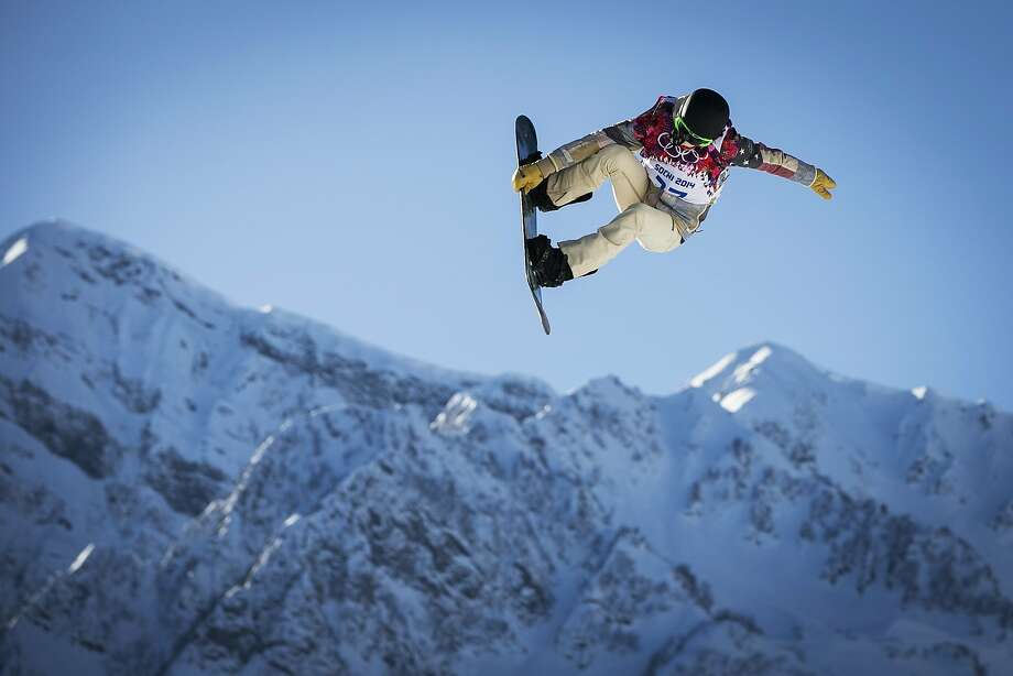 American Shaun White soars off a jump during a slopestyle training run. Several snowboarders have suffered injuries on the course, including White, who fell and jammed his left wrist while practicing. Photo: Lucas Jackson, Reuters