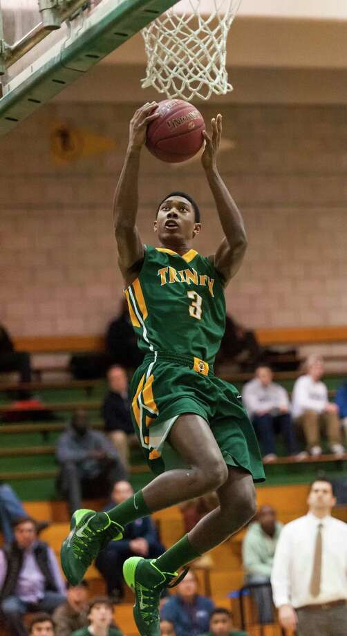 Trinity Catholic high school's Tremaine Frasier goes airborne for two points during a boys basketball game against Norwalk high school played at Norwalk high school, Norwalk, CT on Tuesday, February, 4th, 2014. Photo: Mark Conrad / Connecticut Post Freelance