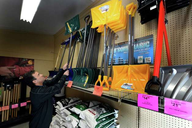John Phillips, owner of Phillips Hardware,  restocks his shelves Tuesday afternoon Feb. 4, 2014 in Colonie, N.Y., in preparation for a pending storm which should be hitting the area after midnight tonight according to the National Weather Service.        (Skip Dickstein / Times Union) Photo: SKIP DICKSTEIN / 00025626A