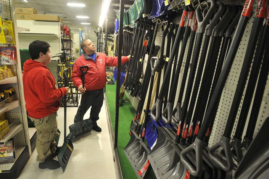 In preparation for the oncoming snow storm Ron Pompa, right, and his son, Christian, pick out shovels for their landscaping business R.P. & Sons at Karp's hardware store in Stamford, Conn., on Tuesday, Feb. 4, 2014. Photo: Jason Rearick