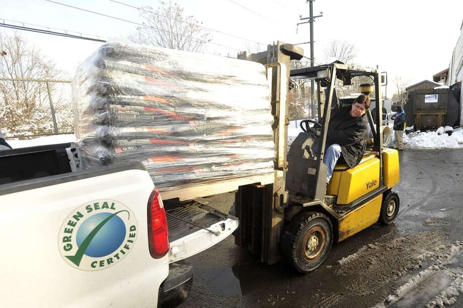 Shirley Beaumont, home and garden manager, loads a pallet of ice melt into the back of a truck for Perfect Building Maintenance behind Karp's hardware store in Stamford, Conn., on Tuesday, Feb. 4, 2014. Photo: Jason Rearick