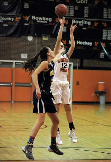 Bethlehem's jenna Giacone goes in for a score during their girl's high school basketball game agains