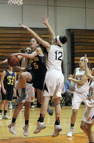 Averill Park's Kelly Donnelly drives to the basket during their girl's high school basketball game a