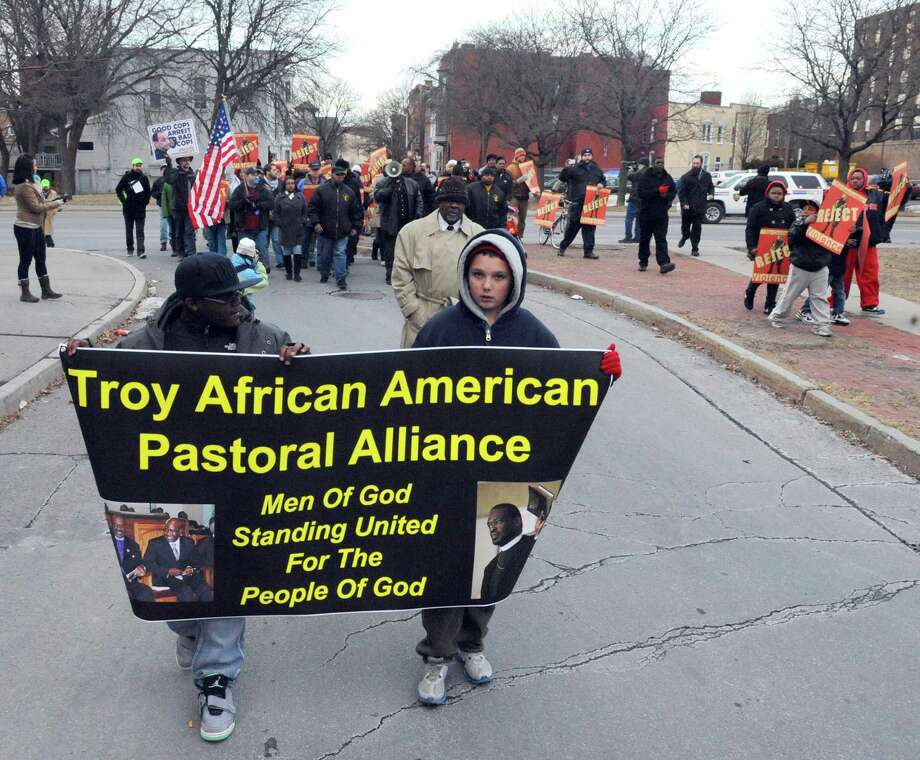 Protestors march up Fifth Ave. during a demonstration against police violence Tuesday evening, Feb. 4, 2014, in Troy, N.Y. The rally was sponsored by the Troy African American Pastoral Alliance.A Troy Public Safety Committee hearing was held Tuesday night to address recent allegations of police brutality. (Michael P. Farrell/Times Union) Photo: Michael P. Farrell / 00025596A