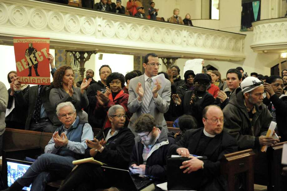 The crowd reacts after Pastor Willie Bacote speaks at a Troy Public Safety Committee public hearing at the Christ Church United Methodist on Tuesday Feb. 4, 2014 in Troy, N.Y. (Michael P. Farrell/Times Union) Photo: Michael P. Farrell / 00025597A