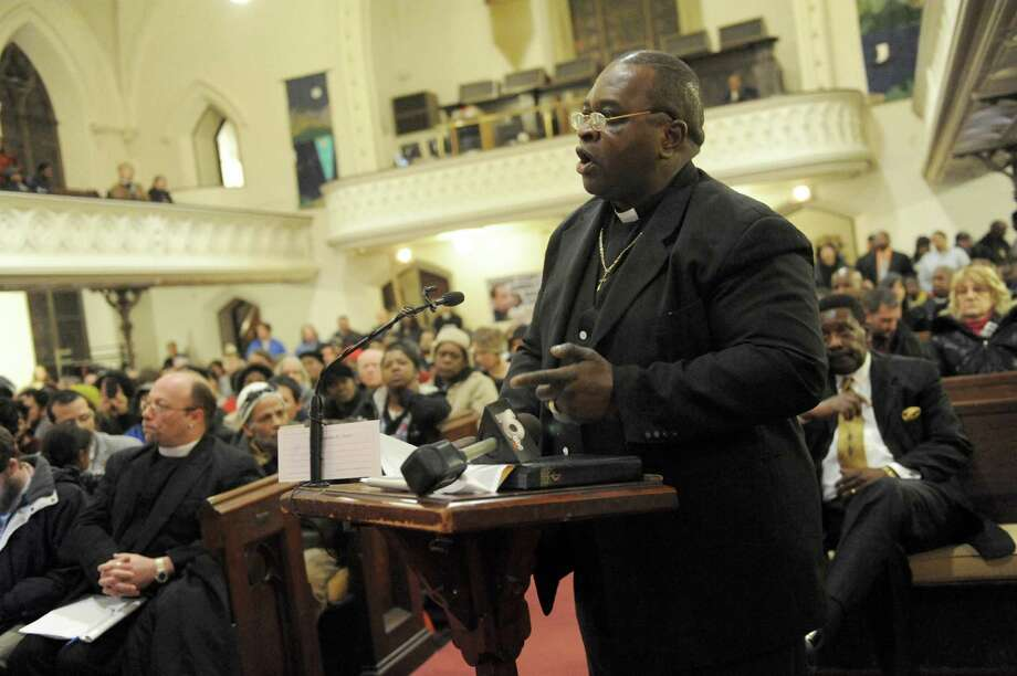 Pastor Willie Bacote speaks at a Troy Public Safety Committee public hearing at the Christ Church United Methodist on Tuesday Feb. 4, 2014 in Troy, N.Y. (Michael P. Farrell/Times Union) Photo: Michael P. Farrell / 00025597A