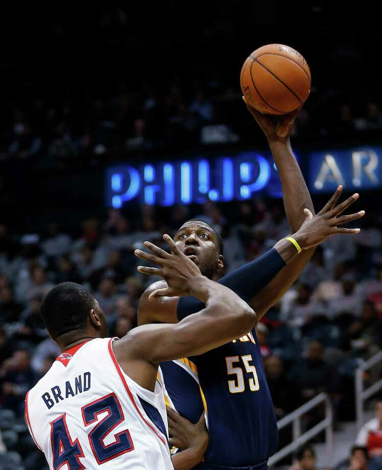 Indiana Pacers center Roy Hibbert (55) takes a shot against Atlanta Hawks power forward Elton Brand (42) in the first  half of an NBA basketball game, Tuesday, Feb. 4, 2014, in Atlanta. (AP Photo/John Bazemore) ORG XMIT: GAJB105 Photo: John Bazemore / AP