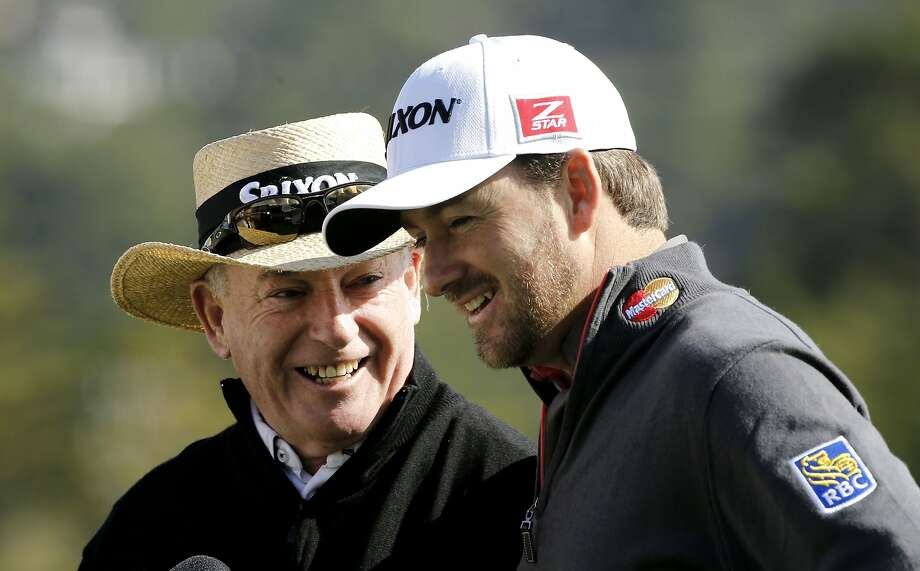 "Kenny and Graeme McDowell share a moment on the 18th green after a practice round at Pebble Beach. The tour pro says playing the event with his dad is a ""bucket list"" opportunity. Photo: Michael Macor, The Chronicle"