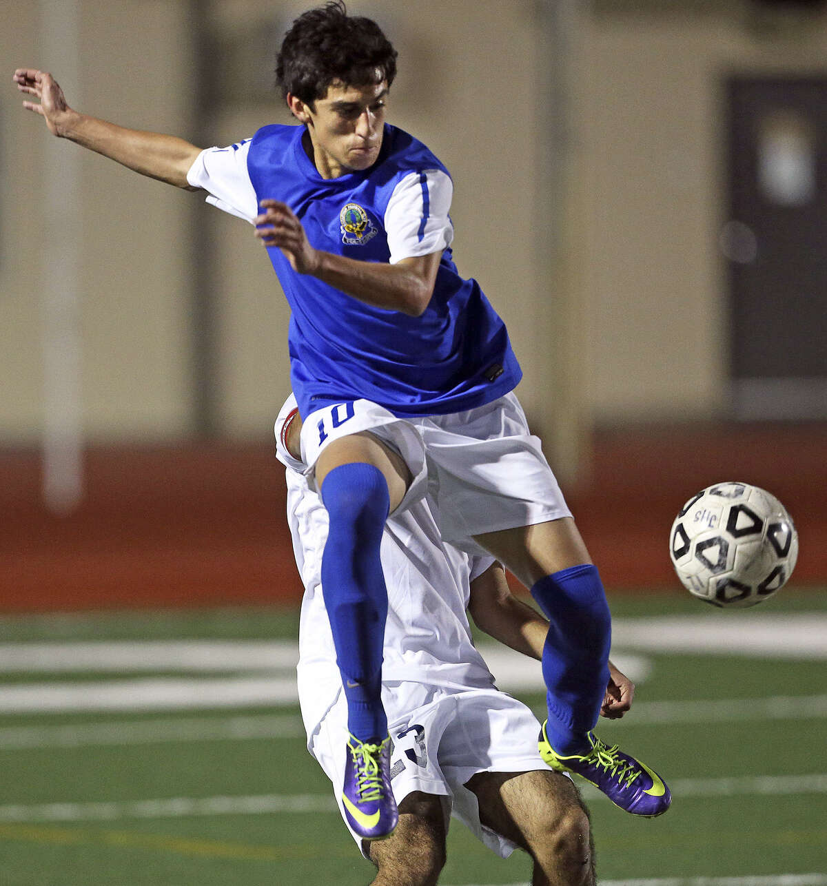 MacArthur's Nickolas Loera goes up to try and control the ball against Johnson. The game was the second half of a District 26-5A doubleheader.