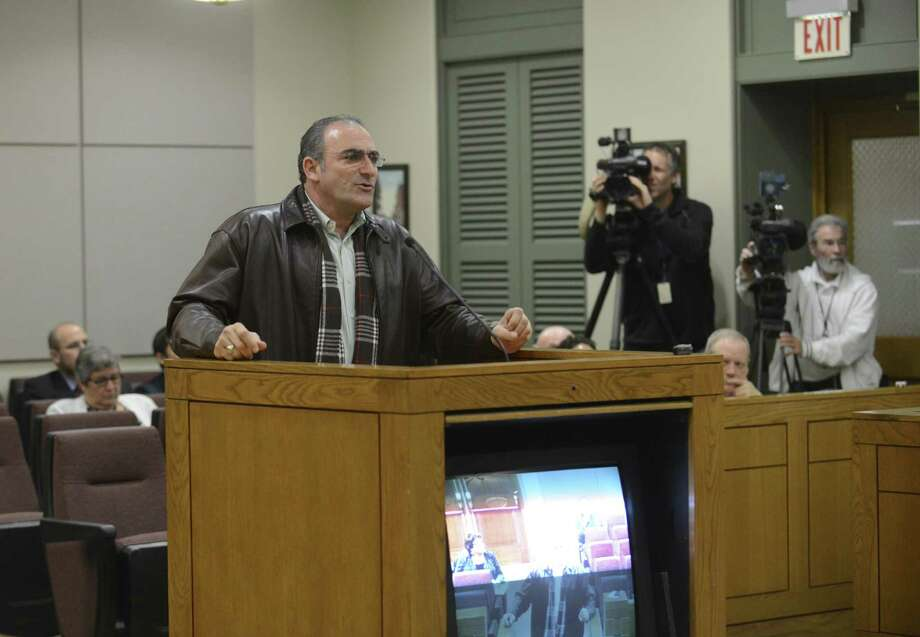 Winslow Swart addresses commissioners. The county vote on gay benefits contrasted with the city's, when throngs spoke to the council. Photo: Billy Calzada / San Antonio Express-News / San Antonio Express-News