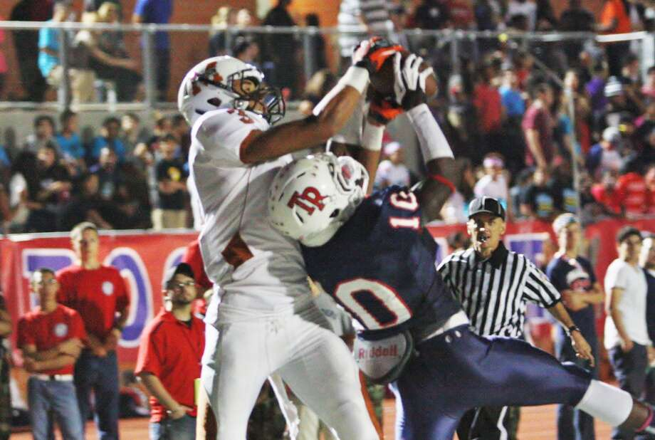 Action photo of Roosevelt's Arrion Springs (right), the area's No. 2 recruit. Photo: Mike Smith, For The NE Herald