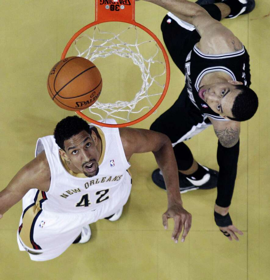 """After getting chewed out by coach Gregg Popovich at halftime Monday, Danny Green (right) """"came through"""" for the Spurs. Photo: Gerald Herbert / Associated Press / AP"""