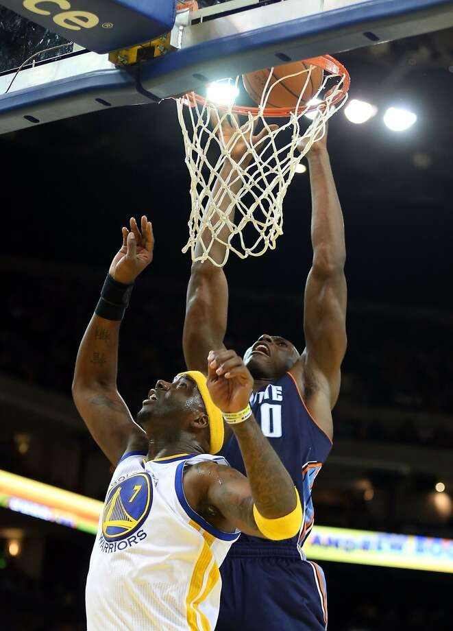 Bobcats center Bismack Biyombo (right) scores over Jermaine O'Neal. Photo: Kelley L Cox, Reuters
