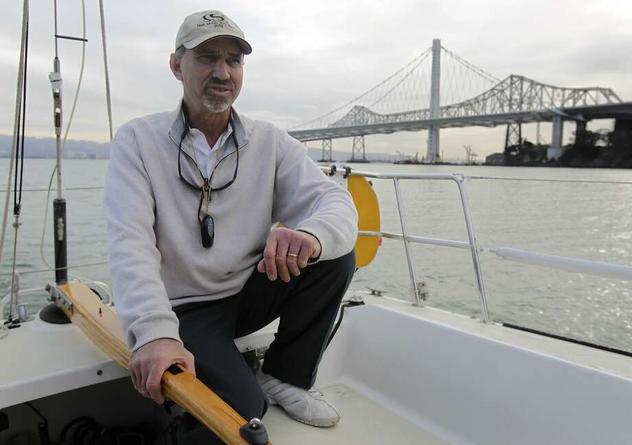 Larry Baskin, steering his sailboat Bullet through Clipper Cove at Treasure Island, has been frustrated by the increasingly shallow channel. Photo: Paul Chinn, The Chronicle
