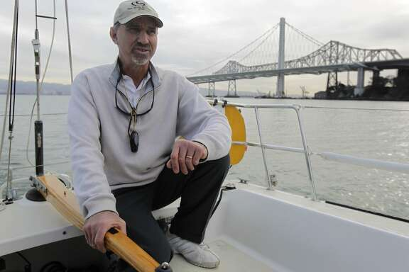Larry Baskin steers his 37-foot sailboat Bullet through Clipper Cove at Treasure Island in San Francisco, Calif. on Tuesday, Feb. 4, 2014. Boaters have to be cautious when entering or exiting the Treasure Isle Marina during low tides because of a sand bar that's overdue for dredging at the entrance to the cove.