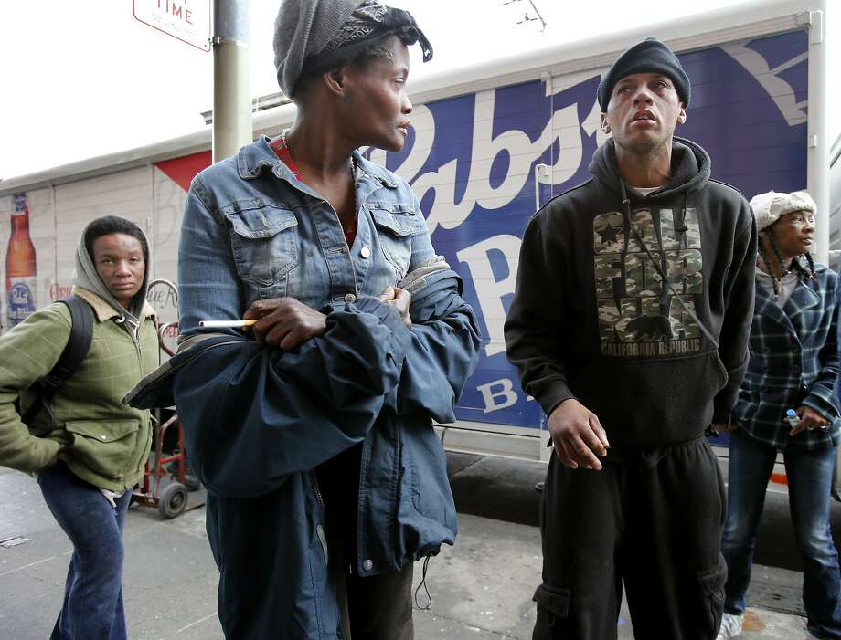 "A group of people gather behind a large liquor delivery truck as it stops on Turk Street Tuesday February 4, 2014 in San Francisco, Calif. Community and homeless organizers have gotten ""no parking"" signs along the first block of Turk Street, an area with a longtime drug problem. They say that parked cars and trucks provide cover for illegal activities on the block. Photo: Brant Ward, The Chronicle"