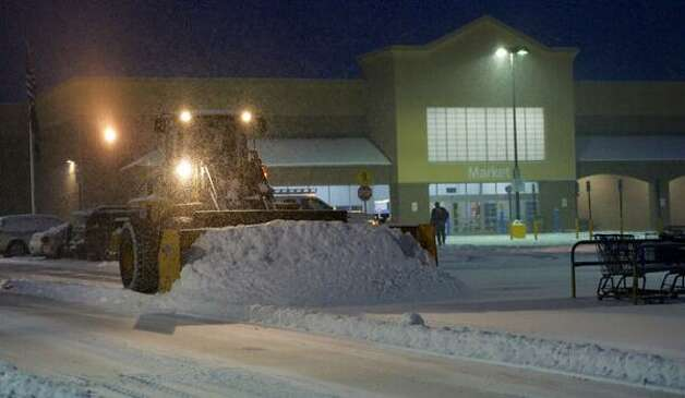 The snow is back - and lots of it too. The National Weather Service says up to a foot of snow could fall. In this picture, a plow clears snow at the Walmart in Clifton Park. (Skip Dickstein / Times Union)