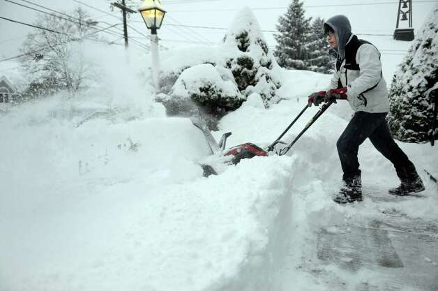 Stefan Skok, 16, uses a snowblower to clear snow from sidewalks on Deer Hill Avenue in Danbury, Conn. during a snowstorm, Wednesday morning, Feb. 5, 2014. Photo: Carol Kaliff / The News-Times