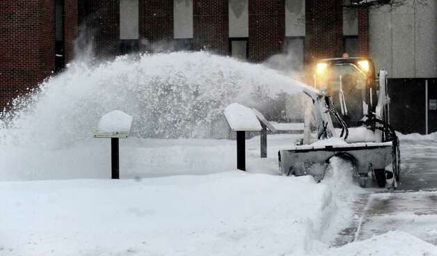 A snowblower clears snow from the walks at City Hall in Danbury, Conn. during a snowstorm, Wednesday, Feb. 5, 2014. Photo: Carol Kaliff / The News-Times