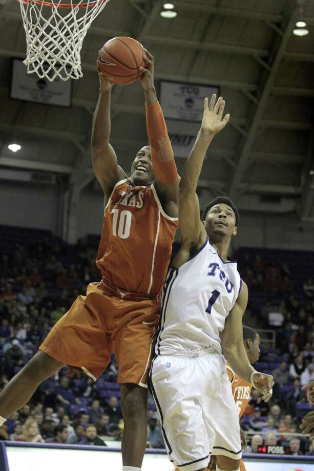 TCU Horned Frogs' Charles Hill Jr. loses a rebound to Texas Longhorns' Jonathan Holmes in Fort Worth, Texas, on Tuesday, Feb. 4, 2014. (Ron T. Ennis/Fort Worth Star-Telegram/MCT) Photo: Ron T. Ennis, McClatchy-Tribune News Service / Fort Worth Star-Telegram