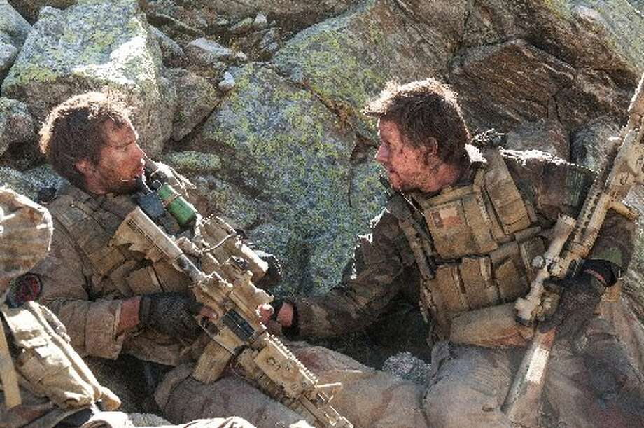 """Lone Survivor,"" starring Mark Wahlberg, is based on the best-selling book of the same same by Texas' own Marcus Luttrell, a former Navy SEAL who was part of a mission in Afghanistan that went terribly wrong. (Universal Pictures)"