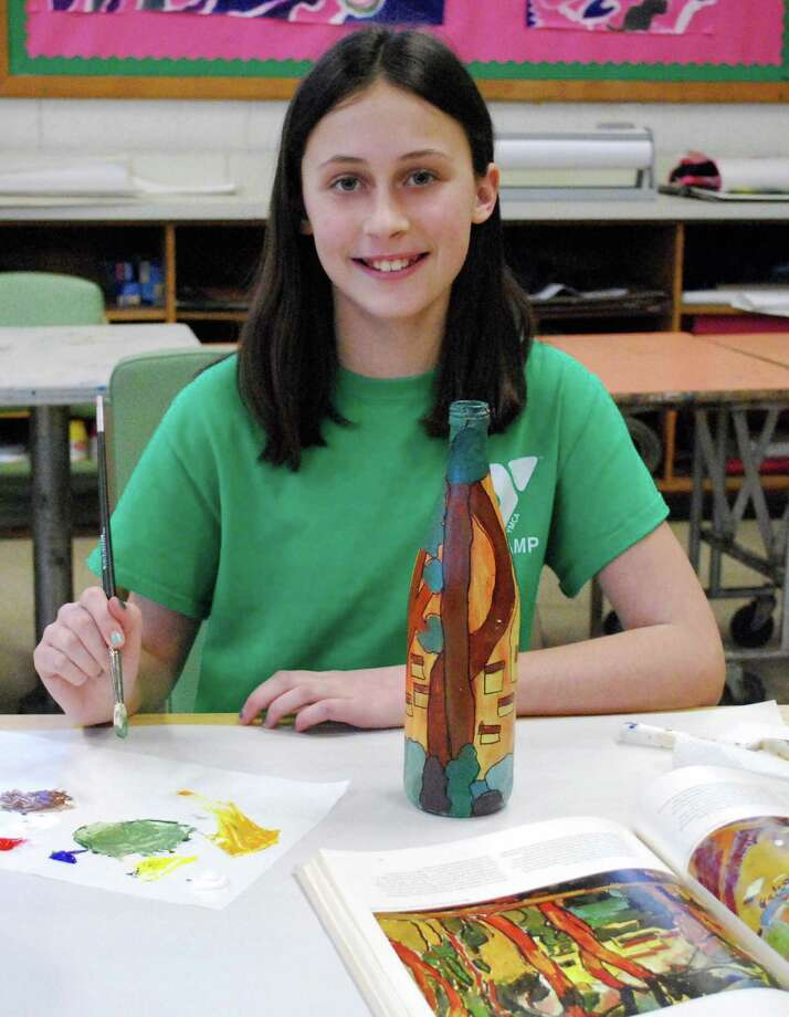 "Darien Arts Center student Jenna Funkey puts the finishing touches on her artwork that will be featured in the ""Drawn to Nature"" art show at the Darien Nature Center during the month of February. Photo: Contributed Photo, Contributed / Darien News"